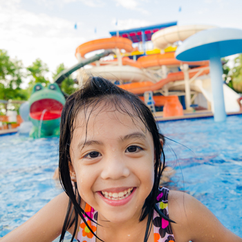 Young girl swimming at a water park