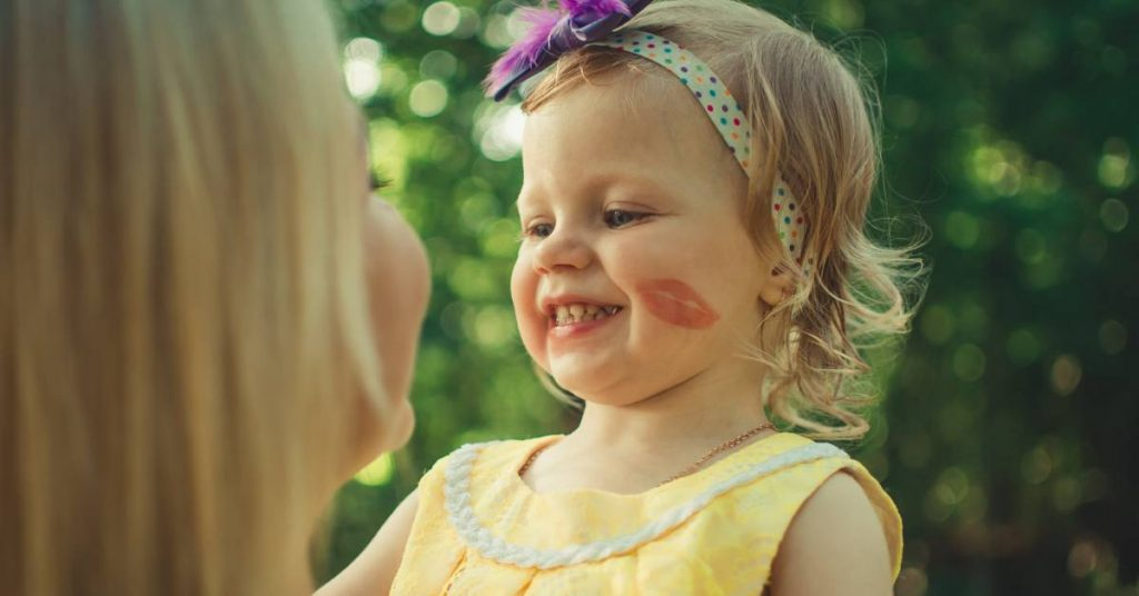 Young girl smiling at her mom